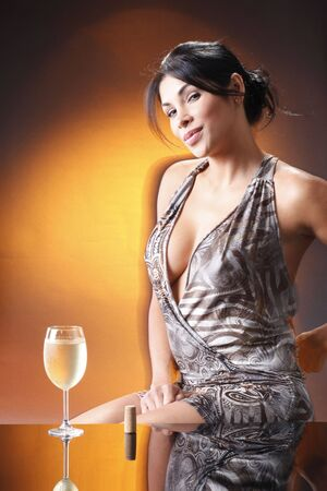 Cute brunette and a cold glass of white wine photo