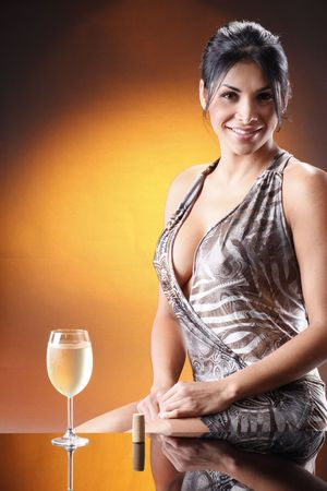 woman mirror: Cute brunette and a cold glass of white wine