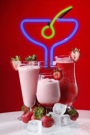 Strawberry cocktail or smoothies, daiquiri, martini, shortcake and kiss photo