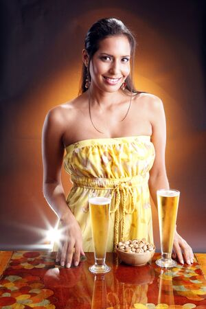 Cute brunette and goden beer. Matches golden beer collection. photo
