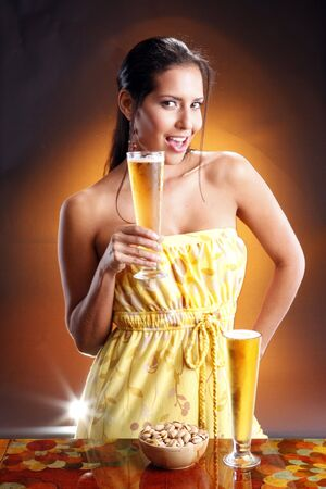 alcoholic drink: Cute brunette and goden beer. Matches golden beer collection.