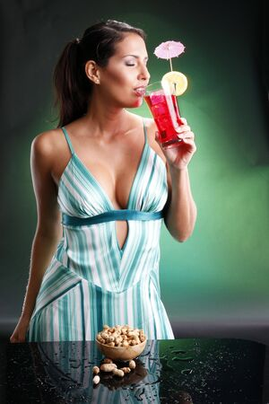Cute brunette and grenadine. Matches happy drinks on teal collection. photo