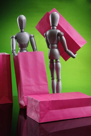 Silver dummies carrying gift bags