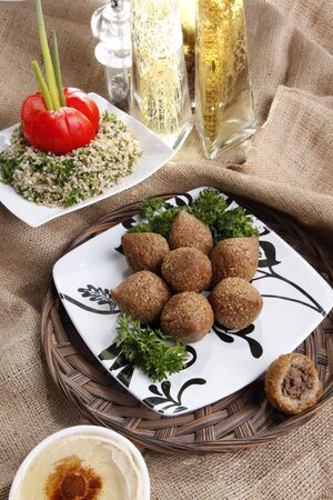 Middle eastern Fried Kibbe with Tabouli and Hummus Tahine Stock Photo
