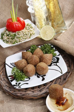 Middle eastern Fried Kibbe with Tabouli and Hummus Tahine Imagens - 5355639