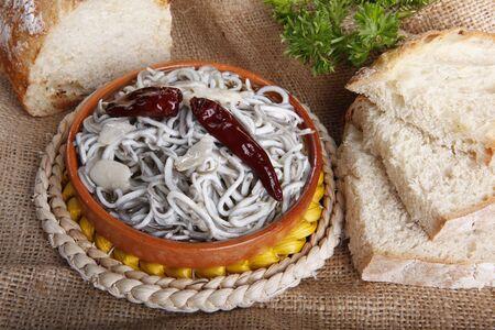 cazuela: conger eel oven fried in olive oil, served in terra cotta dish