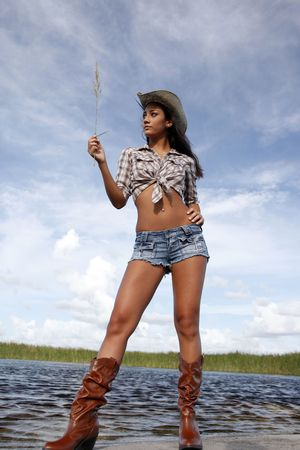 Cowgirl in shorts and the Everglades marshes
