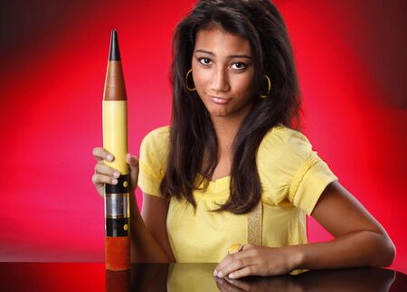 oversized: Teenager using an oversized pencil
