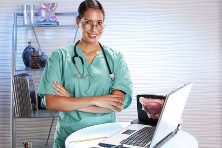urologist: Urologist keeps records with a laptop Stock Photo