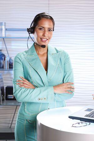 customer records: Customer support professional keeps records updated with a laptop Stock Photo