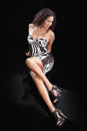 Cute brunette and print dress on black Stock Photo - 5440023