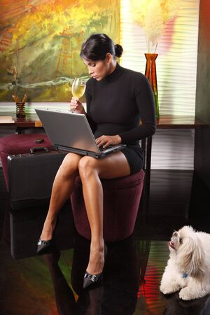 standing reception: Time to update records online before walking the dog Stock Photo