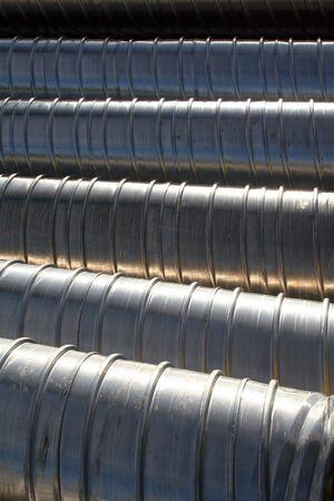 deconstruct: Metallic reinforced undergound tubing awaiting installation, texture