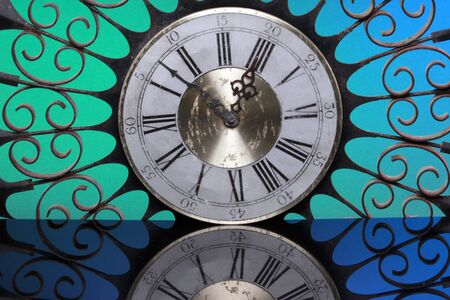 raggedy: Decorative vintage clock framed with an iron radial structure Stock Photo