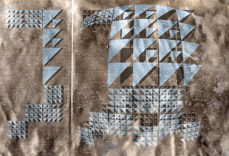 aligning: Metallic  geometric shapes made to wrap by aligning the seam to the fold Stock Photo