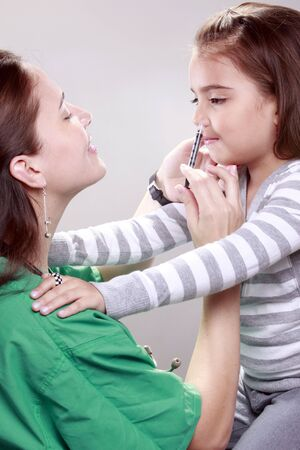 Preteen gets a swine flu shot from her doctor photo
