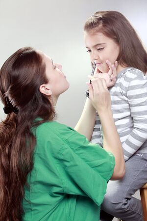Preteen gets a swine flu shot from her doctor Stock Photo - 5674565
