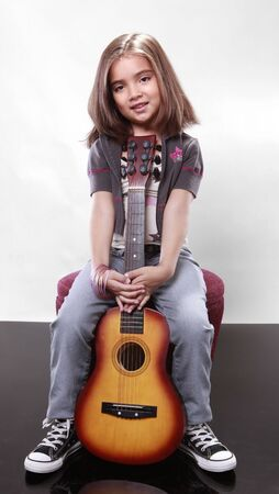 beautiful preteen girl: Young girl and her guitar