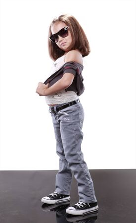 children acting: Cute kid in jeans and sunglasses
