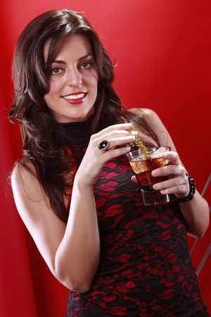 Close up of cute brunette enjoys a Black Russian photo