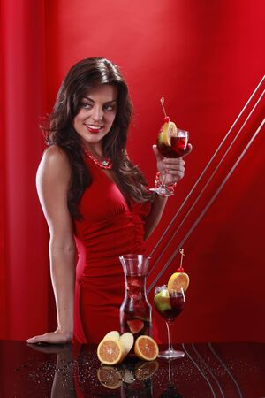Cute brunette enjoys a glass of sangria photo