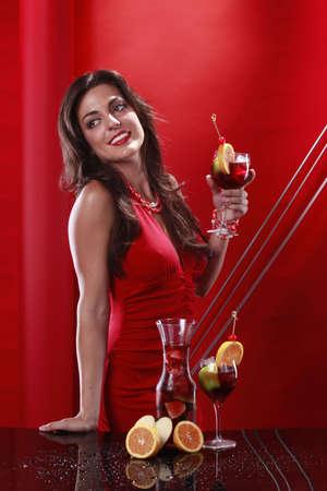 Cute brunette enjoys a glass of sangria photo