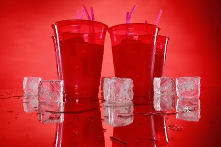 slushy: Kids party vanilla shake in red cups and matching background