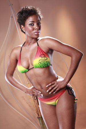 Cute black girl in rainbow glow bikini photo
