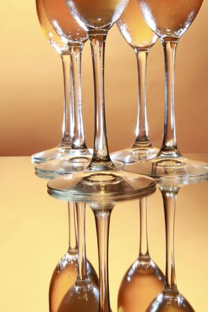 Flute stems mirrored with golden background Reklamní fotografie