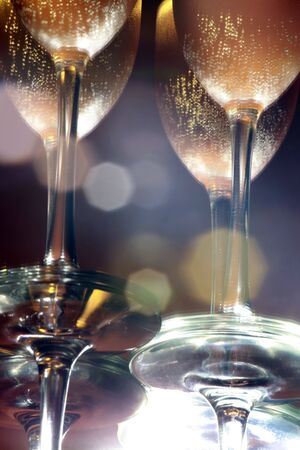 Reflection of flute glasses of sparkling wine
