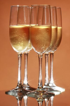 Sparkling wine on salmon background