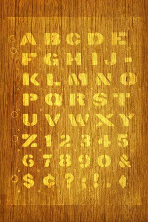Stenciled alphabet on fine wood photo