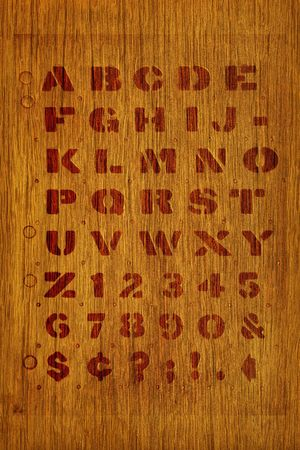 Stenciled alphabet on fine wood