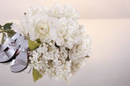 Wedding favors and flower bouquet with space for typesetting photo