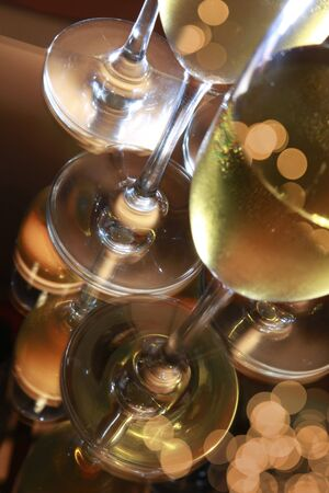 mitzvah: Reflection of flute glasses of sparkling wine
