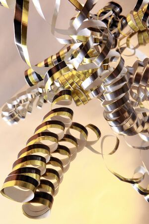serpentines: Curly serpentines cascading on a mirror on white Stock Photo