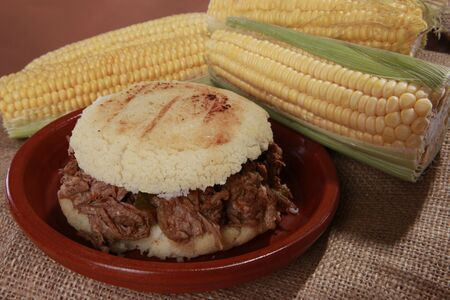 Arepa carne mechada - Srhedded beef corn patty from South-America photo