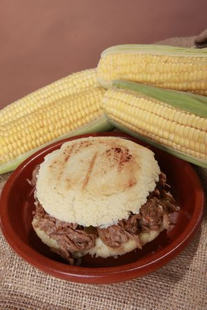 colombian food: Arepa carne mechada - Srhedded beef corn patty from South-America