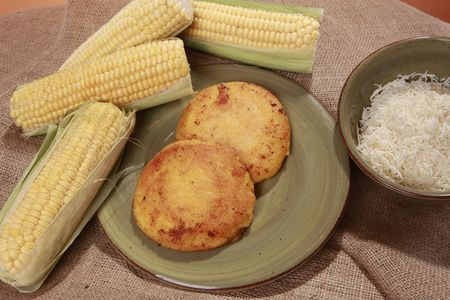 colombian food: Arepa de choclo - South-American corn dough muffin with white cheese filling