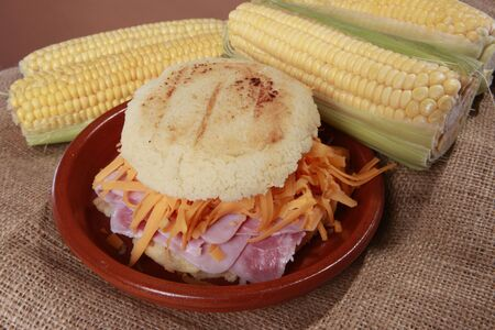 patty: Arepa hamon y queso - Cheddar and ham corn patty from South-America Stock Photo