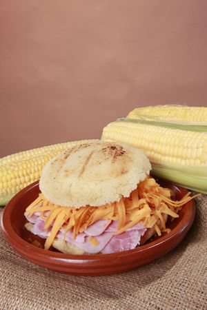 colombian food: Arepa hamon y queso - Cheddar and ham corn patty from South-America Stock Photo