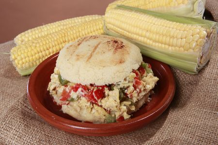 colombian food: Arepa perico criollo - Creole egg scramble corn patty from South-America