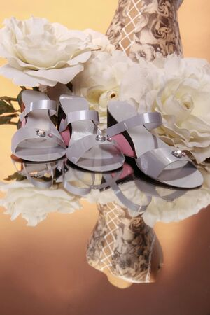 Wedding fashion presentation with bouquet and favors photo