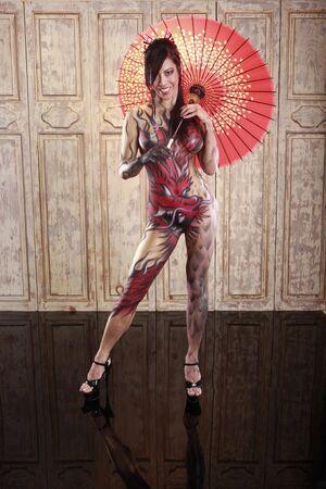 Dragon bodypainting asian girl with umbrella Stock Photo - 6082527