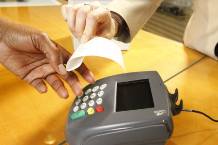 paying: Getting a receipt through a merchants terminal Stock Photo