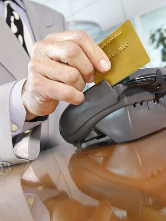 key card: Your brand here. Swiping a Credit-Debit rewards Card through a merchants terminal