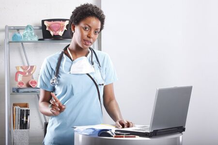 Cute afro-american doctor at her office Stock Photo - 6593931