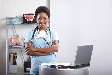 Cute afro-american doctor at her office Stock Photo - 6593890