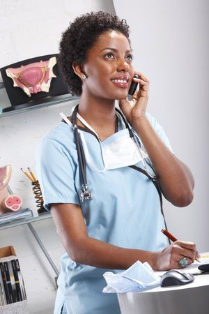 Cute afro-american doctor at her office Stock Photo - 6593887