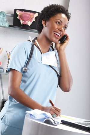 Cute afro-american doctor at her office photo